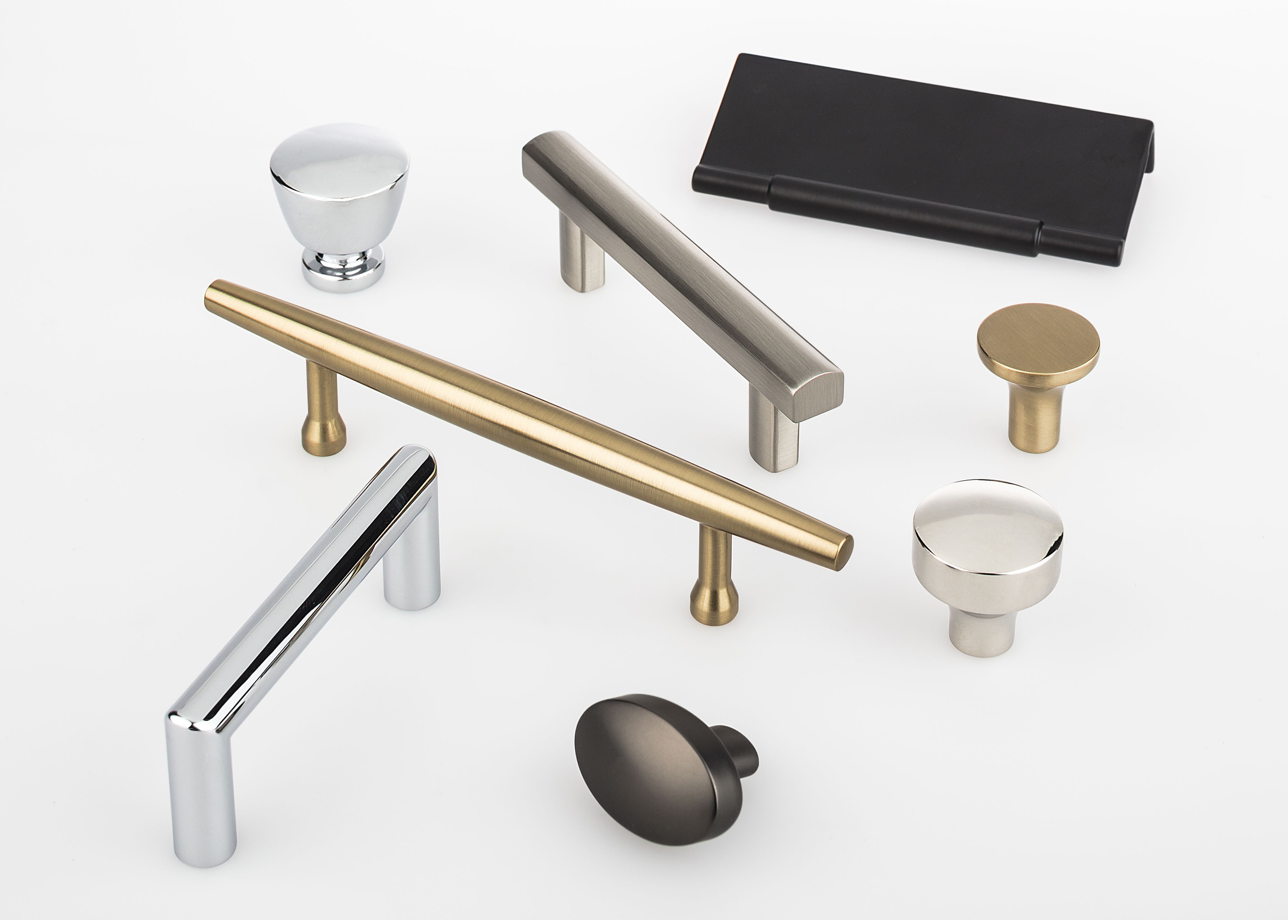 This collection of knobs pulls cup pulls and backplates mimics the minimalistic shapes found in furniture and architectural styles from the mid 1930s to