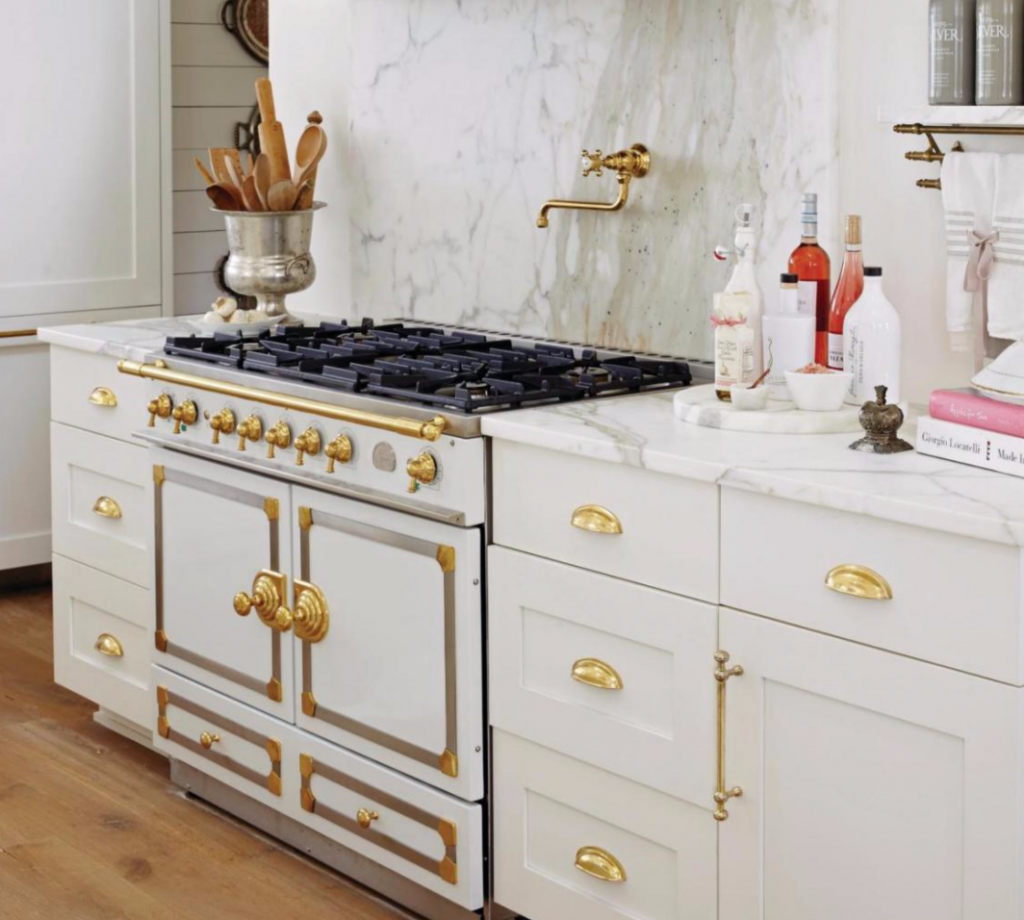 Brass Top Knobs hardware in French Countryside Kitchen