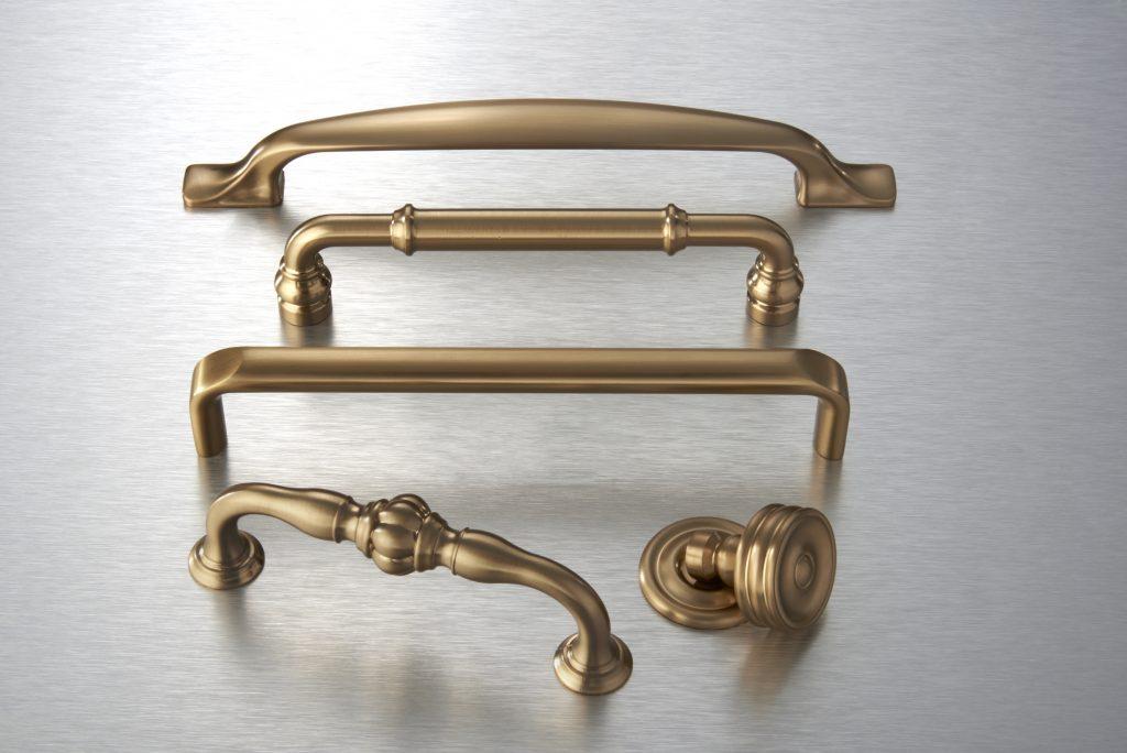 Top Knobs Devon decorative hardware in Honey Bronze Finish